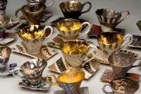 group of porcelain cups and sourcers