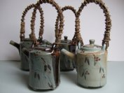 Teapots with wisteria cane handles